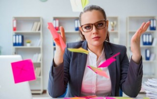 Lady with post-it notes taking decision