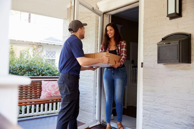 Courier delivering parcel to a client