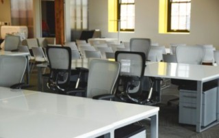 multiple empty desks in an office room